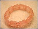 Fashion trend 2005 online wholesale  rose quartz beads forming fashion stretchy bracelet. Rose quartz can enhance emotional balance. Very good for expressing and soothing emotions. You can still benefit from this bracelet jewelry form its perfect pinky rose color.