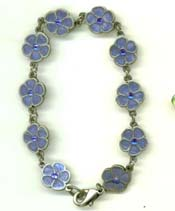 Unique handcrafted gift accesory online shop offering charm bracelet with multi enamel blue color flower pattern decor. A great gift suitable for every age!