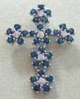 Traditional religious design on new trendy fashion. Multi blue and clear cz forming flower cross charm. All women love it. Perfect for gift giving!